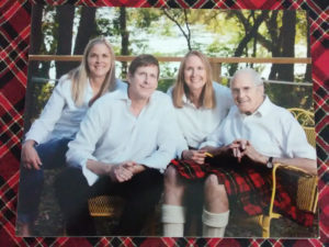 Dr. Forrest is shown in his Scottish kilt. His three children are from left to right, Anne, Hugh and Eleanor.